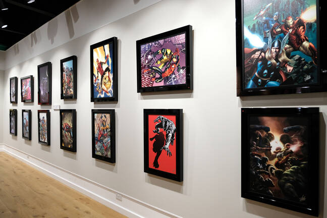 Previous Marvel artworks from The Legacy Collection are displayed on a gallery wall